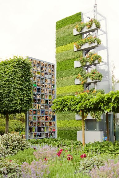 "abluegirl:  Living Wall  These vegetated surfaces don't just look pretty. They have other benefits as well, including cooling city blocks, reducing loud noises, and improving a building's energy efficiency.What's more, a recent modeling study shows that green walls can potentially reduce large amounts of air pollution in what's called a ""street canyon,"" or the corridor between tall buildings. For the study, Thomas Pugh, a biogeochemist at the Karlsruhe Institute of Technology in Germany, and his colleagues created a computer model of a green wall with generic vegetation in a Western European city. Then they recorded chemical reactions based on a variety of factors, such as wind speed and building placement. The simulation revealed a clear pattern: A green wall in a street canyon trapped or absorbed large amounts of nitrogen dioxide and particulate matter—both pollutants harmful to people, said Pugh. Compared with reducing emissions from cars, little attention has been focused on how to trap or take up more of the pollutants, added Pugh, whose study was published last year in the journal Environmental Science & Technology. That's why the green-wall study is ""putting forward an alternative solution that might allow [governments] to improve air quality in these problem hot spots,"" he said.Compared with reducing emissions from cars, little attention has been focused on how to trap or take up more of the pollutants, added Pugh, whose study was published last year in the journal Environmental Science & Technology. That's why the green-wall study is ""putting forward an alternative solution that might allow [governments] to improve air quality in these problem hot spots,"" he said.  Full Gallery"
