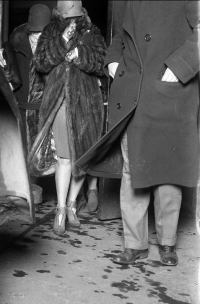 The wife of Peter Gusenberg leaves the morgue after identifying her husband's body, who had been one of 7 killed at 2122 N Clark St during 1929's St. Valentine's Day Massacre. Chicago Tribune Archives