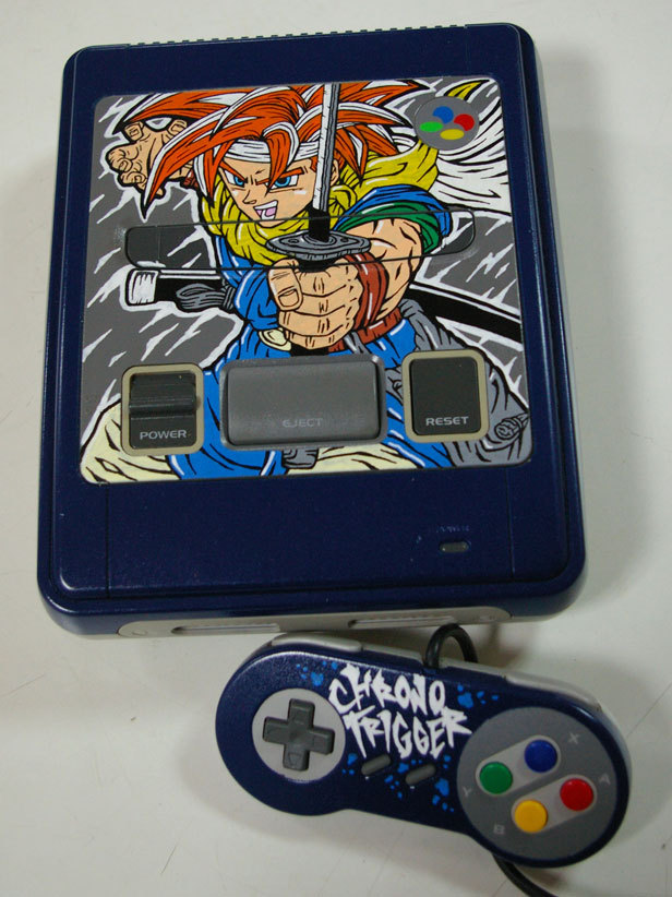 Chrono Trigger Super Famicom System Geek artiste and thingamajig customizer extraordinaire OSKUNK applied his POSCA marker skills to a Super Famicom with a tribute to one of gaming's greatest RPGs. Check it: More OSKUNK PostsBuy: Chrono Trigger for DS