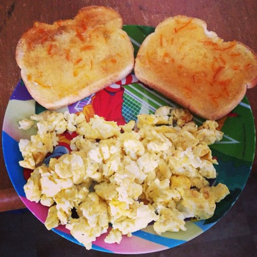 #photoanhour 2 pm - brunch of scrambled eggs And toast with orange marmalade. Nom!