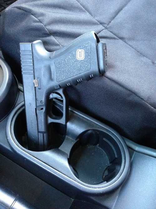 aboyandhisboomstick:  Glock 23 in jeep cup holder