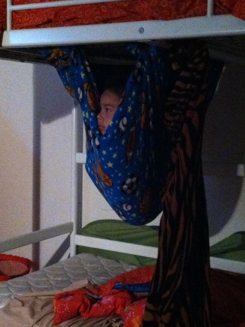 braydaaan:   my brother made a 'hammock' and has been watching tv like that for an hour  omfg