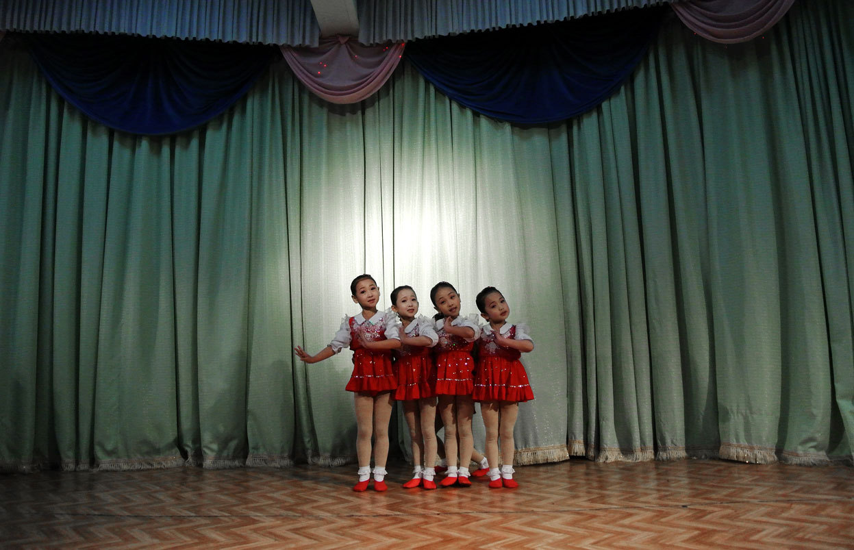 From A Look Inside North Korea, one of 38 photos. This picture taken on December 15, 2012 shows North Korean girls dancing during a performance at a nursery school in the North Korean border town of Siniuju, across from China's northeastern city of Dandong. (Wang Zhao/AFP/Getty Images)