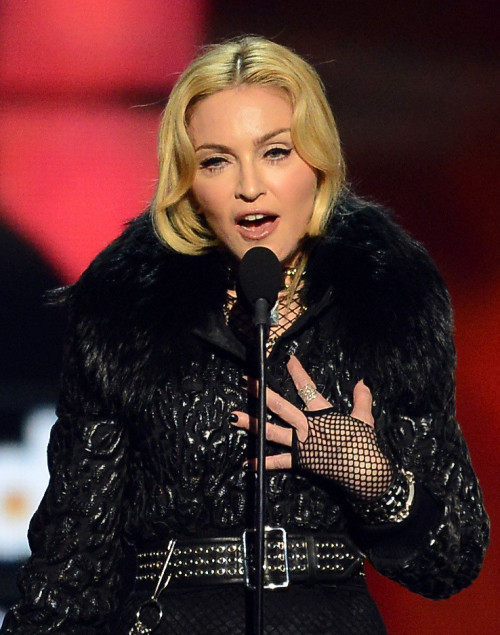 "Singer Madonna accepts the award for ""Touring Artist of the Year"" onstage during the 2013 Billboard Music Awards at the MGM Grand Garden Arena on May 19, 2013 in Las Vegas, Nevada."