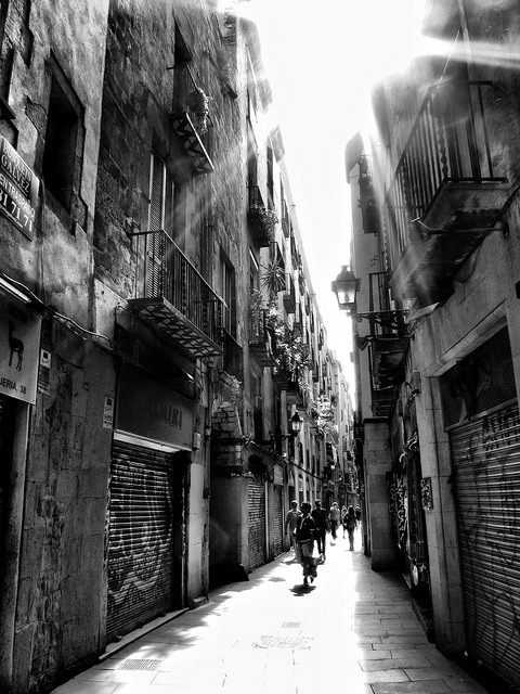 Rays of light through the narrow alleys of Barcelona by jimiliop on Flickr.
