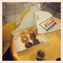 The things we do to doughnuts for shoots.  (at Krispy Kreme Doughnuts)
