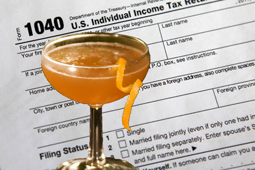 Income tax cocktail with IRS form 1040.