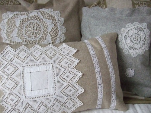 I love lace doilies sewn onto cushion covers!