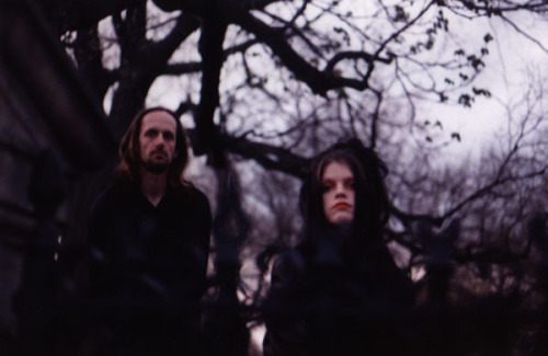 "Darkwave pioneers Lycia are not only re-issuing their classic 1996 album ""Cold"" in June, they're releasing their first new full-length album since 2003's ""Empty Space."" The new album, entitled ""Quiet Moments,"" will be released digitally and in a limited-edition CD format on August 20th by Handmade Birds.  At their official Facebook page Tara Vanflower of Lycia shared her impressions of the new material this past October:  ""This is Tara posting for Lycia. I haven't even heard the album! Mike is keeping it under type wrap. What I have heard (one unfinished track) is like Stark Corner/Cold moodwise mixed with some solo MV and something wholly new. Vague much, vanflower? LOL I'm as excited as anyone to hear this!!!!""  The reformed Lycia's last release was the 2010 EP ""Fifth Sun."" Here's ""We Sleep in Winter"" from that EP."