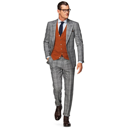 suitsupply:  A brightly-colored knitted vest is the perfect way to add some personal flair to your everyday grey suit. http://bit.ly/1FpltqJ