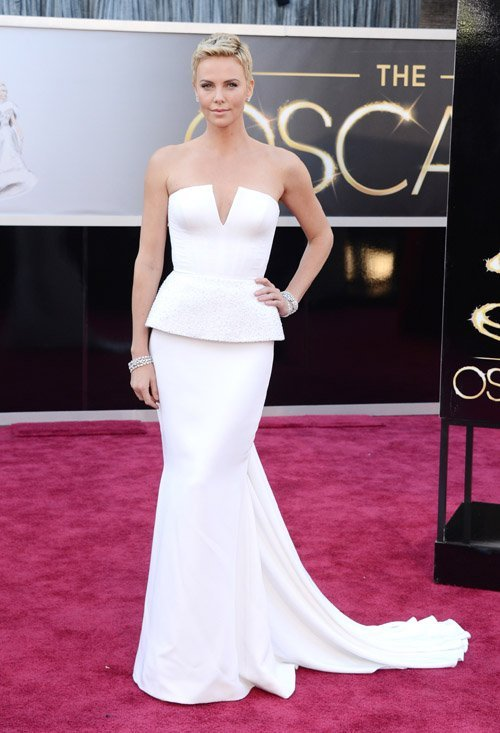 Charlize Theron arrive at the Oscars held at Hollywood & Highland Center on February 24, 2013