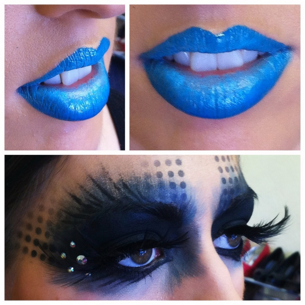 Here is a quick look I created yesterday for a feather & latex shoot. Blue gradient lips using a LimeCrime lipstick in the centre, and a Blue pout paint from Sleek around the outer edge of the lips.  For the eyes, it's a simple look. I didn't want anything to precise or neat, so I used a splayed out brush and dragged Black face paint up and out around the eyes. I made a stencil with tiny hole in and sprayed through it using my airbrush.  I filled in the centre of the lids with the same Black face paint, and sprayed over it with my airbrush for a more opaque look. Then I added a hint of watery blue to the edges, using the same technique.   I placed some AB Flip Swarovski crystals at the corners just to spruce it up a bit. Feather lashes added to match the feathers in the outfit - Done!
