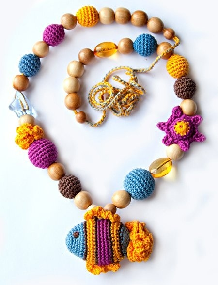 This necklace caught my eye, and I love the colors and shapes! It's great use of crochet to make all those different beads. It took me a while to find more information about it (lots of people use Pinterest as the source or credit and it drives me crazy!). I know it is a necklace for new moms because the textures and shapes function as something for the baby to focus on. But what I'm not sure of is who credit goes to. I *think* it's bisiki on Etsy, but I am not certain.