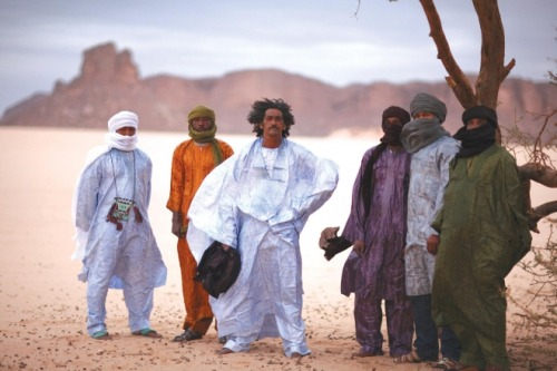 "(via Hot To Mali) ""The backstory of Tinariwen founder Ibrahim Ag Alhabib is so cinematic in scope that it should be the basis for an epic independent film. The Mali native was only 4 when he watched as soldiers executed his father, a Tuareg rebel, during an uprising in the early '60s.  Later in childhood, Ag Alhabib saw a Western film where a cowboy played a guitar; he was so intrigued he fashioned his own instrument out of a tin can, a stick and a piece of bicycle brake cable. By the late '70s, Ag Alhabib had learned many Tuareg Folk melodies and modern Arabic Pop songs during his time in Libyan and Algerian refugee camps, and had obtained an actual acoustic guitar from a local Arab man. He joined forces with other musicians in the Tuareg rebel community to form a band in order to play parties and weddings, which locals dubbed Kel Tinariwen, loosely translated as 'The People of the Desert…' …TINARIWEN headlines the Friday night opener of the MusicNOW festival at Memorial Hall, which runs through Sunday. More info: musicnowfestival.org."""