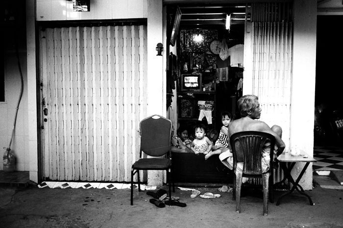Ho Chi Minh City (Saigon), Vietnam. July, 2012  A family and their home.