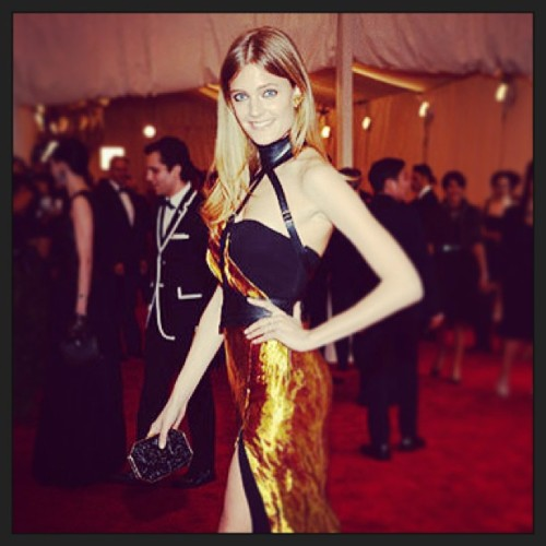 Constance Jablonski looking radiant in @wes_gordon carrying Amanda Pearl at the Met Ball. #punk #goddess #MetBall