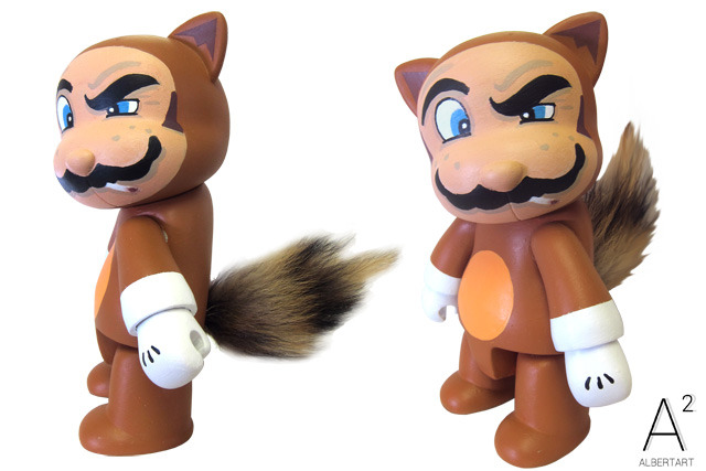 Custom Tanooki Suit Mario Qee Custom vinyl toy artist Albert Art turned one of Toy2R's 8-inch Cat Qees into a stogey-smoking Mario rocking his raccoon suit. No actual raccoons or tanookis were harmed in the making of this custom. Check it: More custom toys on AlbotasBuy: Collectible & DIY Qee figures