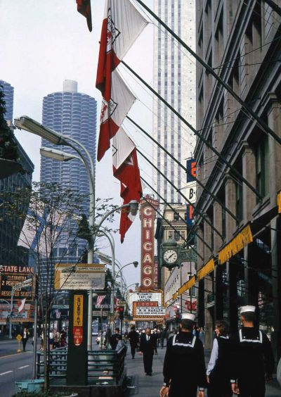 North on State to Randolph, 1963, Chicago  What's interesting here is that the same film, Cleopatra, starring Elizabeth Taylor and Richard Burton, is showing at both the Chicago Theater and the State and Lake Theater. Demand must have been high!