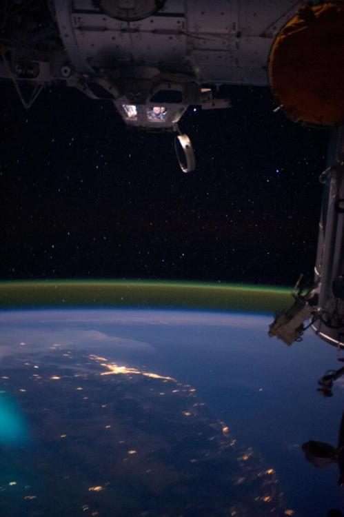 the-star-stuff:  NASA astronaut Ron Garan looking down at a night view of Australia from the International Space Station's cupola..