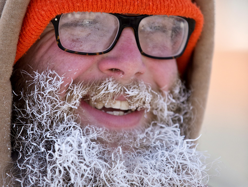 The Week in Pictures for Dec. 30th Pete Hipko deals with fogged-up glasses and icicles on his beard as he braves sub-zero temperatures as he walks to City Market in Burlington on Friday, January 3, 2014. (Photo by GLENN RUSSELL/FREE PRESS)