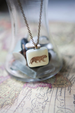 http://www.etsy.com/listing/76727383/tiger-fused-glass-pendant-necklace?ref=sr_gallery_43&ga_search_query=tiger+animals+necklace&ga_view_type=gallery&ga_ship_to=ZZ&ga_page=3&ga_search_type=all