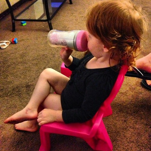 Look how adorbz my niece is! Crossing her legs, drinking her bottle, while watching tv. :)  #niece #adorbz #adorable #redhead #goof #cute #girl #family #shesonly3 #pink #black #chair