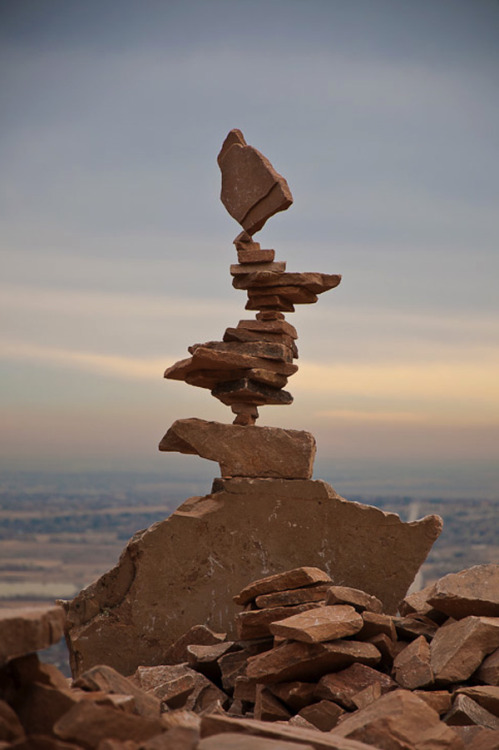 Stone Stacking Sculptures by Michael Grab These incredible stone sculptures are held together by nothing more than gravity. Each stone is precisely positioned to counterbalance the other rocks in the stack. I have no idea how much time is taken on each sculpture but the level of patience needed to continuously alter the stones position by tiny fractions is stagering. I give up so easily on intricate things and this is just astonishing to me. I've embedded a point of view video that shows the entire process of creating a relatively small stone structure to help put things into perspective.  Artists: | Website | YouTube | [via: Faith is Torment]  Watch: