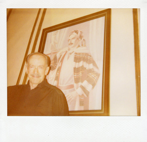 "thepresentcompanyproject:  Roi with his portrait from the 70s. Washington, DC. ""I am as happy as I want to be!"" Photo by Amber Mahoney."
