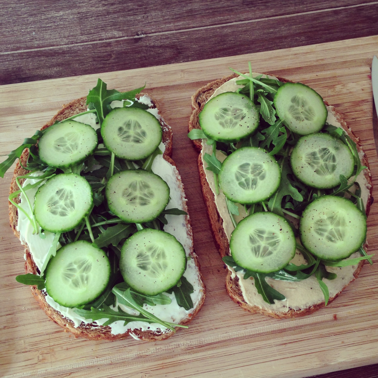 vegan-yums:  healthfityoga:  phitspiration:  melanie-is-healthy:  Lunch: 2 slices whole wheat pumpkin bread with cream cheese arugula and cucumber and the other with hummus arugula and cucumber seasoned with black pepper!  looks so good ommogmogmog  AHHHHHHHHHHHHH  Yum! just use vegan cream cheese.