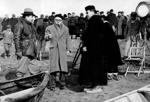 Julien Duvivier gives direction to Gino Cervi and Fernandel on location for Le petit monde de Don Camillo.
