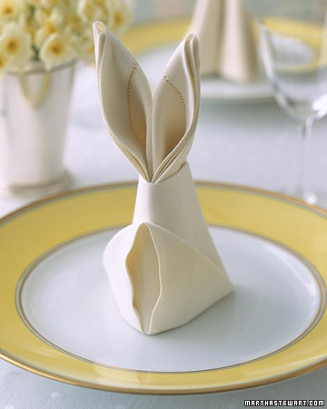 "Happy Easter!  (To fold your own napkins — ideally reusable cloth napkins — into ""rabbits,"" see this tutorial from Martha Stewart.)"