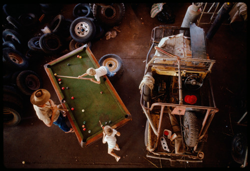 natgeofound:  A rancher plays pool with his children in their garage, Western Australia, May 1989.Photograph by Sam Abell, National Geographic