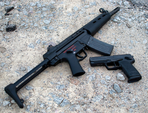 s0w1:  HK53 & USP45 by SupraMK86 on Flickr.  We have only one of these two firearms available to rent at work. It's not the one you'd expect. There's something wrong with that.