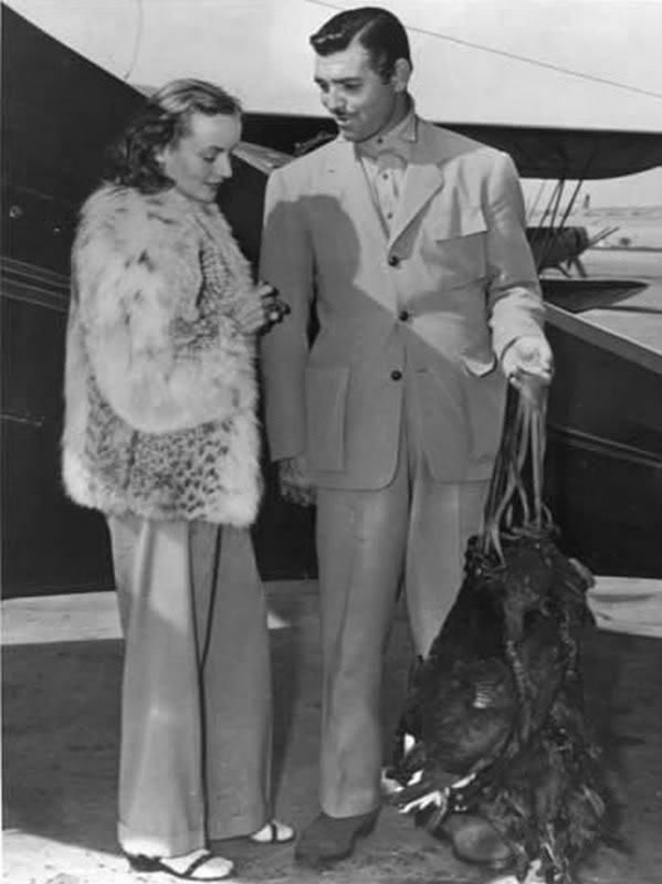 Clark Gable and Carole Lombard with the carcuses of dead birds.