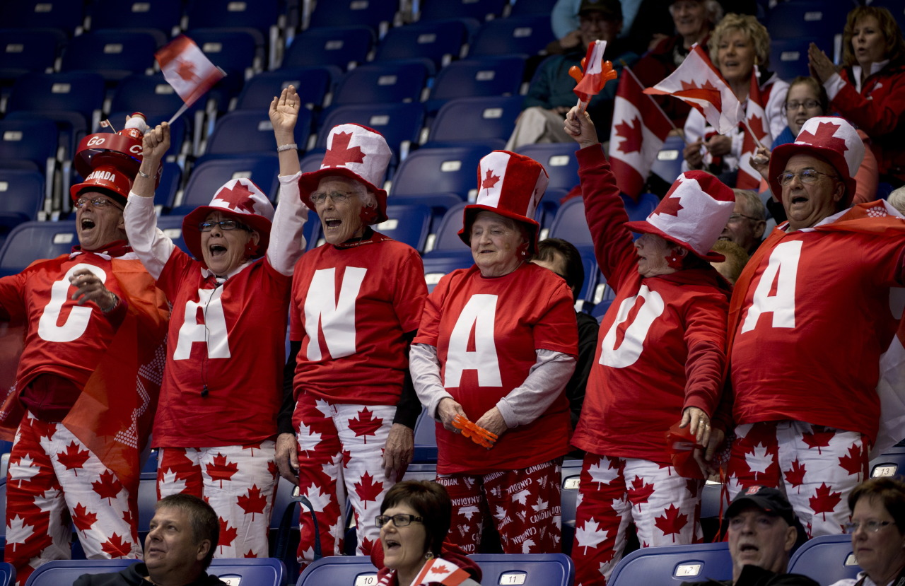 nationalpostphotos:  Dressed to impress, Canada curling fans cheer during an evening draw at the World Men's Curling Championship in Victoria, B.C. Tuesday, April 2, 2013. THE CANADIAN PRESS/Jonathan Hayward