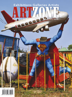 "Cover: Superman and Friends, photograph, 2013 Featured in ARTZONE Issue No. 49 2013  Collisions of Memory and Abandonment Local artist Sanjay Theodore has returned to India, his country of birth. The collisions of memory, colour and anarchy have had a galvanizing effect upon his art practice. Catharina van Bohemen talks to him about his recent work.   The photograph is taken through the window of a plane. The sun has gilded its wingtip which gleams over a blue cloud-scattered expanse. The image suggests immensity, possibility, perhaps rupture, but curiously, because of how it's framed, it's also a blue eye looking back at you. An aeroplane for Indian-born, NZ educated artist Sanjay Theodore might also release an early memory: he grew up in North India with borders near Pakistan and China, as a child he remembers the flash of anti-aircraft fire in the night sky. In 1974 his family left India because of the war with Pakistan, and two years later they came to live in New Zealand. Recently, family circumstances have compelled him to return to India, and his artistic practice, always political and organic, is up for reassessment. When we Skype, he is in a church in a red light district in Mumbai. The room is quiet but our conversation is punctuated by shrieks, sirens and barking dogs – you never forget that people are everywhere, or that the gap between rich and poor is the wheel of a Bentley nudging past a family clustered round a pot of lentils. Sanjay says that right now painting seems ""inappropriate"" – the painting as object and luxurious commodity in a place stuffed with objects but unattainable for so many, superfluous and irrelevant. ""I'm not looking for anything"" he says, ""but everything is surprising. So I'm taking photographs, but not with an expensive camera – just a small low res phone camera – which seems right somehow for India."" A MIG fighter, pinioned in a garden. The plane's elegance, its delta wings and sculpted nose doesn't alter the fact that MIGs were used by the Indian Air Force against Pakistan during the late 60's and early 70's. The photograph is a balance of light and shade, or menace and beauty: the plane thrusts darkly across a cloudless sky, its silhouette exposes the sheen of the bomb attached to its fuselage, and the fact that it's much bigger than the surrounding trees and walls emphasises its destructive power. In India, however, the urge to remember competes with a lackadaisical approach to maintenance: In the warplane is stuck on small poles on a pitted concrete dome in a memorial park. It's cracked, broken and powerless and a satellite dish squashed into a tiny space has its wires protected by an upended plastic bucket.Superman and friends, photograph, 2013But collisions of memory and abandonment, of order, chaos and energy galvanises Sanjay's practice. He was driving along a motorway recently when he came across a saleyard of abandoned statues. Superman, without his head, is brandishing an aeroplane. Of course. He's accompanied by a fang-baring tiger, an elephant with suspiciously white tusks, and the remains of what may be a fractured gold idol. Their ersatz companionship jolts you into new thoughts about heroes, power, faith and decay. The photograph is a collision of colour, angles and anarchy: superman's wide-apart arms and legs are counter-pointed by the tiger's teeth and the elephant's fangs, as well a welter of stuff: a swing, stone urns, a solitary column, piles of tyres although they could be anything. The sign with the cell-phone – image and numbers is a testament to the tireless business of survival. Sanjay has recently obtained a residency at TIFA, the Talera Institute of Fine & Applied Arts (TIFA) affiliated to the University of Pune. This provides him with the opportunity to immerse himself in the local community both as teacher and artist, and establish contacts with gallerists interested in meeting New Zealand artists. ""Indians have been in NZ since the 1800's,"" he says. ""An Indian guy fell in love with a Maori woman and jumped ship. We've got lots of connections and I want to develop them.""  Essay written by Catharina van Bohemen"
