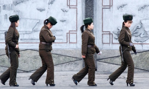 Female North Korean soldiers on patrol along the banks of Yalu River, near the North Korean town of Sinuiju, opposite the Chinese border city of Dandong. From picture desk: live - the best news images of the day. Photograph: Jacky Chen/Reuters