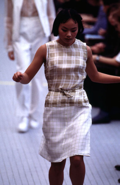 "organization:  Dries Van Noten s/s 1996 ""The show was held in an empty swimming pool. The customary smell of chlorine still pervaded. Only two of the seventy mannequins were professional models. The other sixty-eight were women of all ages and sizes — clearly illustrating the fact that Dries Van Noten creates clothes for wearing, not just showing."" Belgian Fashion Design"