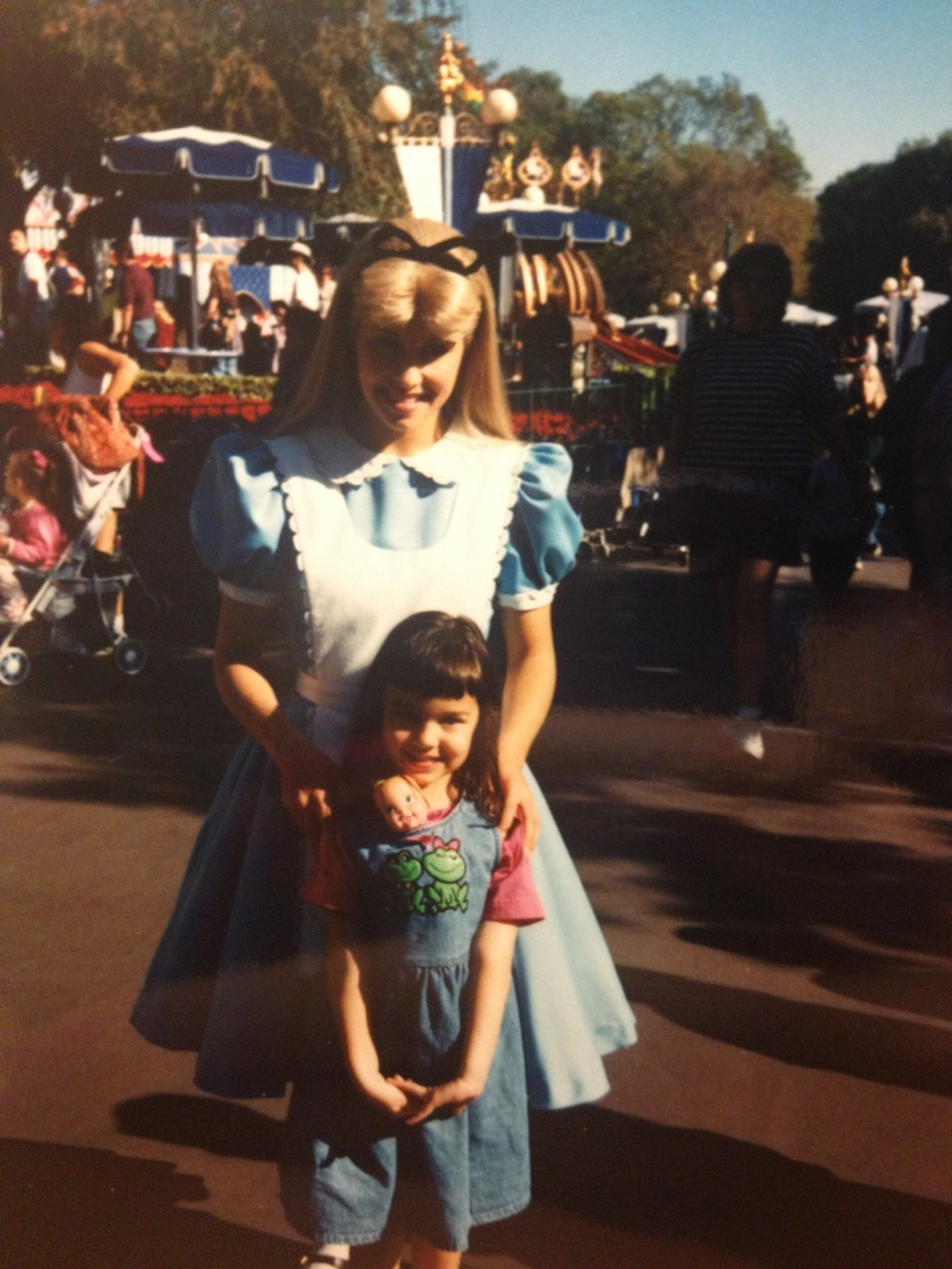 disneyfreak94:  First time I met Alice. I had my baby doll in my dress…