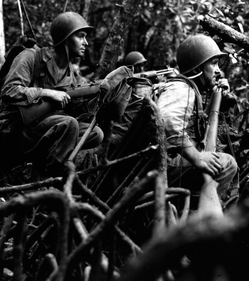 "Infantrymen of Company ""I"" await word to advance. The Solomon Islands, 1943. Schuman"
