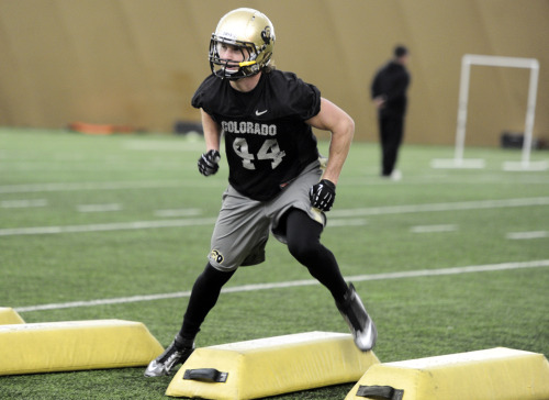 Following in Impressive Footsteps CU's Addison Gillam, an inside linebacker on the football team, hopes to start as a true freshman like Jordan Dizon did in 2004. Read more about this rising player. Above, Addison Gillam runs an agility drill during practice on April 16. (Photo by Paul Aiken)