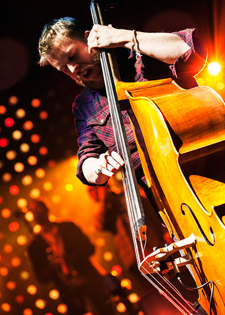 Ted Dwane of Mumford & Sons performs at the TD Garden in Boston on February 5, 2013. Photo © Matthew Shelter/Stage Light Photography (Website/Facebook/Twitter).