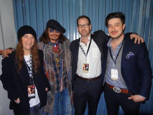 "Marcus Mumford of Mumford & Sons with Patti Smith, Johnny Depp, and Bryan from The Signature Library backstage at the MusiCares Person Of The Year Honoring Bruce Springsteen in Los Angeles on February 8, 2013. According to Bryan: In between performances I spent most of the evening hanging out backstage, spotting Johnny Depp as he came by to say hello to Marcus Mumford and Cary Mulligan [sic]. As I was introduced to Marcus & Carey by Johnny, the legendary Patti Smith came over and joined our little circle. As we were all chatting, another rock n' roll icon, Neil Young was walking by and about to take the stage but not before stopping to say hello to Depp, when he was teased by Marcus Mumford not to get nervous, saying, ""Don't Fuck up Neil, Don't fuck it up""."