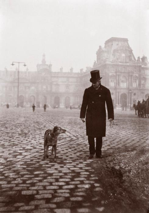 1bohemian:  Painter Gustave Caillebotte and his dog in front of the Louvre, 1876