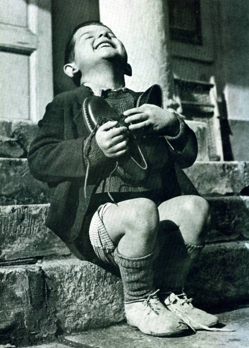 historicporn:  3 year old orphan is pleased with his new shoes.1946.