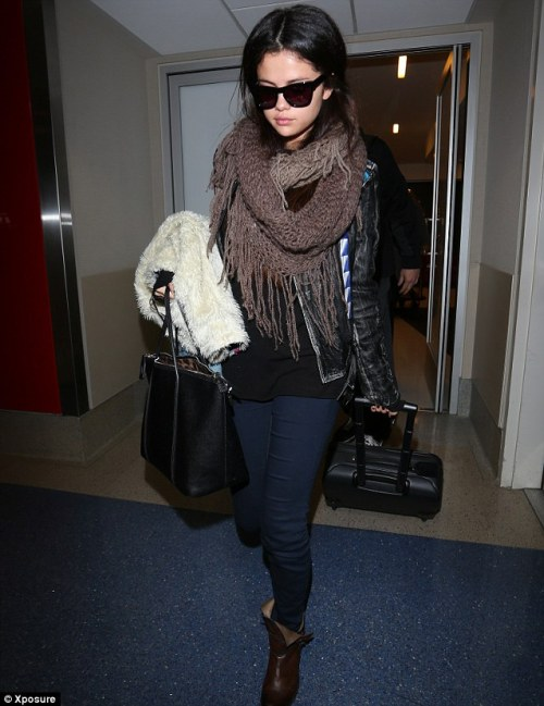 Celebrity Scarf Watch: Selena Gomez wearing a fringed knitted scarf in LAX.