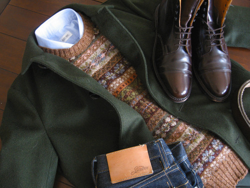 "Loden Coats I wrote a post last month about a Loden coat I picked up from Aspesi, and since then, have received more emails about that it than anything else I've ever written. Some people want to know more about the Aspesi coat; others ask where else they can buy one. So, in an effort to put everything in one place, I thought I'd list some options here. The term Loden refers to a soft, exceptionally durable cloth (usually green) that has a slightly hairy look. For its thickness and density, it's great at keeping out the cold, and because of the natural oils inside the wool, it's fairly water resistant. Most of all, however, it's very beautiful. A Loden coat, then, is simply a garment that's been made from this cloth. The classic model is a single-breasted garment that ends just below the knee. The back is made with a very deep center vent that swings out from the shoulder blades, and the front has a fly opening. It's a peasant's coat, originally worn by Bavarian farmers and hunters sometime in the 11th century. A 1956 article in Sports Illustrated had this great line about it: ""Loden is to the Bavarian what tweed is to the Scot – a fabric so long indigenous to its land, of such peasant origins that it has become almost a folk cloth."" Those origins helped make it immensely popular with European preps in the 1980s, but since then, it seems to have been forgotten (though, The Sartorialist had a great shot of a man in Milan wearing one earlier this year). It's still a wonderful, classic coat however. You can wear it with jeans or corduroys; checked shirts or sweaters; and wingtips or boots. Everything that made it appealing thirty years ago, in my opinion, still holds – the cloth, the drape, and of course the color.    The one I have is from Aspesi, an Italian company most known for their outerwear. The product shot on their website suggests that it's shorter than it is. Mine comes just above the knee, and I'm of average height. I admit I wish it were longer, but on the upside, it's slim enough to fit my unusually skinny frame, and the back comes without the center vent (something I thought might be too conspicuous for my lifestyle). Aspesi also makes two other jackets from the fabric, which you can see here and here, though they're not in the styles I'm focusing on in this post. For the original design, you can turn to Cordings and Schneiders of Salzburg. I haven't handled their particular Loden coats, but everything else I've seen from them has been of very high quality, albeit a bit fuller in fit. Loden coats really should be worn a bit looser anyway, as you can see in their photos. There's also Loden Haus, Born for Loden, and Lodenfrey, the last of which used to be the most popular supplier, though they don't seem to make them for men anymore (they do for women).  In the US, you can enquire at San Francisco Clothing and Princeton's Landau, both of whom sell quality products. As usual, men's coats tend to cost a lot brand new. If you can find something vintage, you'll likely pay a fraction of the cost. On the upside, the designs of classic men's coats have largely remained the same since they were codified. On the downside, it can take a bit more work to find something in your size (especially if you're skinny). Easier if you're looking for the ubiquitous pea coat or trench, but harder if you're looking for something niche like a Loden. To start, however, you can try eBay."