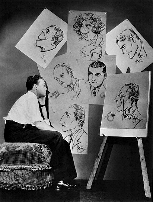 James Cagney looking at studio drawing cards, c. 1930s