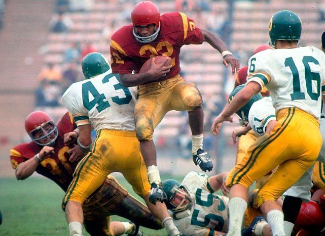 O.J. Simpson runs up the middle during a game against Oregon. Simpson led the nation in rushing both seasons he played for USC and won the Heisman in 1968. (Walter Iooss Jr./SI) GALLERY: Greatest College Athletes of All Time
