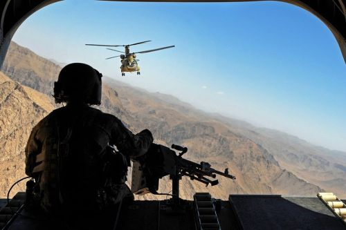 semperannoying:  Sgt. Zach Smola, rear door gunner on a CH-47, keeps watch on the mountains in Uruzgan province, Afghanistan. The Chinooks, operated by members of Bravo Company, 2nd Battalion, 104th Aviation Regiment from the Connecticut and Pennsylvania Army National Guard, have played a vital part in the mission in Afghanistan since their arrival in December 2012 by performing resupply, retrograde, and planned missions.  (U.S. Army photo by Sgt. Jessi Ann McCormick)